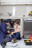 Couple plumbers fixing the pipes Royalty Free Stock Photography