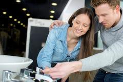Couple at plumbing store choosing sink royalty free stock photo