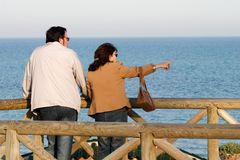 A couple point at the sea Royalty Free Stock Photography