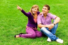 Couple pointing Stock Photo