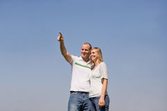 Couple Pointing Stock Image