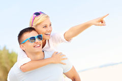 Couple pointing at the beach Stock Image