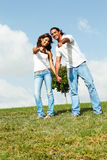 Couple pointing at camera Royalty Free Stock Photos