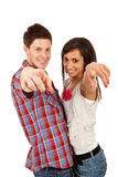 Couple pointing at the camera Stock Image