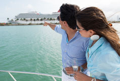Couple pointing at a cruise Royalty Free Stock Image