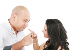 Couple pointing at each other Royalty Free Stock Image