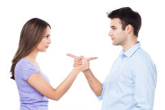 Couple pointing at each other Royalty Free Stock Photos