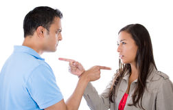 Couple pointing fingers at each other, blaming each other for problem Royalty Free Stock Images