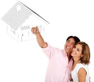 Couple pointing a house Stock Photo
