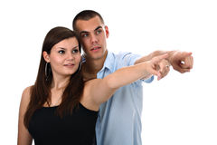 Couple pointing index fingers to side isolated Royalty Free Stock Image