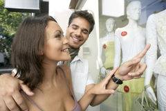 Couple Pointing at Shop Window Stock Photography