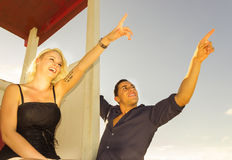 Couple pointing the sky Royalty Free Stock Image