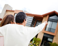 Couple pointing at their dream home Stock Image