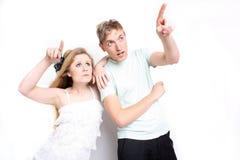 Couple pointing upwards Stock Photos