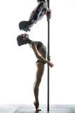 Couple of pole dancers with body-art on pylon Stock Photo