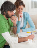 Couple Pondering Their Financial Plan Royalty Free Stock Photography