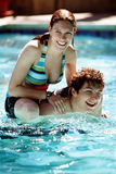 Couple in the pool. Happy couple in the pool Royalty Free Stock Photo