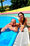 Couple in the pool. Happy couple in the pool Stock Image