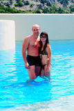 Couple in the pool. Happy couple in the pool Royalty Free Stock Image