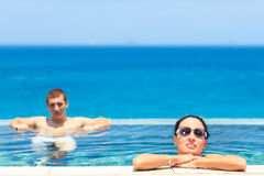Couple in pool Royalty Free Stock Image