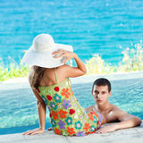 Couple in pool Stock Images