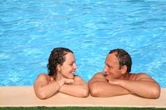Couple in the pool Royalty Free Stock Image