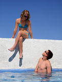 Couple by the pool. A teen girl flirting with a boy in the pool Stock Photo