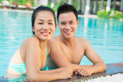 Couple in the pool. Close up portrait of a young couple in the swimming pool on the foreground Royalty Free Stock Photo