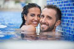 Couple in the pool Stock Photography