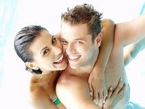 Couple pool. Latin couple in love enjoying in a swimming pool Stock Photo