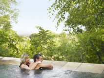 Couple In Pool Looking At View Royalty Free Stock Image
