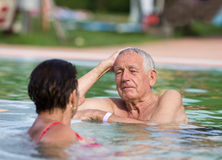 Couple in the pool Stock Images