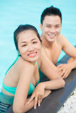 Couple in pool Royalty Free Stock Photo