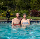 Couple in pool in yard Stock Photography