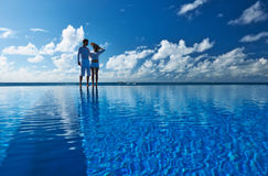 Couple at the poolside. Against sky royalty free stock photography