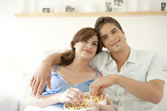 Couple With Popcorn Smiling Royalty Free Stock Images