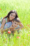 Couple in poppy field Royalty Free Stock Photos