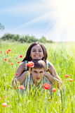 Couple in poppy field Stock Image