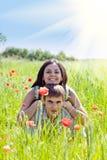 Couple in poppy field Stock Image