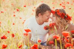 Couple on the poppy meadow Stock Image