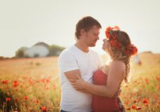 Couple on the poppy meadow Stock Images