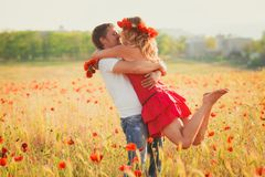 Couple on the poppy meadow Stock Photos