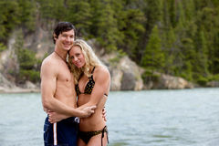 Couple Portrait on Beach. A portrait of a happy near a river in Banff, Canada stock image