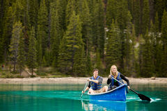 Couple Portrait in Canoe. A portrait of a happy copule in a canoe on a glacial lake stock photos