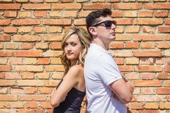 Couple portrait in front of brick wall stock image
