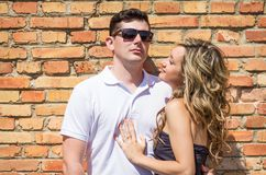 Couple portrait in front of brick wall Stock Photography