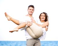 Couple Posing Against a Bright Background Stock Photo