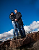 Couple posing against deep blue sky Royalty Free Stock Photography