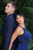 Couple posing back to back Stock Photo