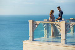 Couple posing on a balcony Royalty Free Stock Image